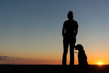 silhouette of a woman and her dog