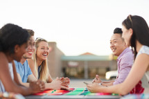 friends talking around an outdoor table