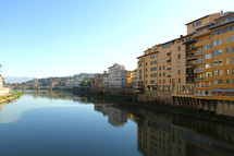 View of the Arno River from the Ponte Vecchio Bridge in Florence