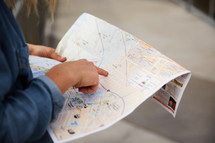 woman looking at a street map