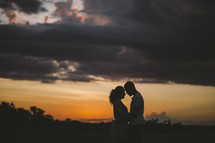 a couple embracing at dusk