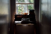 a secretary desk in a window