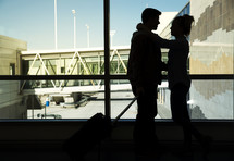 couple with luggage at the airport
