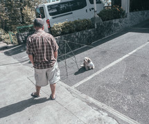 a man looking at a lost dog