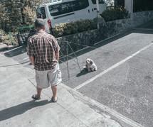a man looking at a lost dog