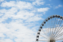ferris wheel in a blue sky