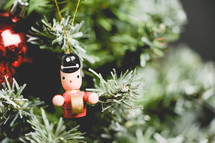 little drummer boy ornament on a Christmas tree