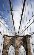 Web of cables suspending bridge.