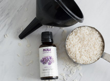 funnel, lavender essential oils, and rice