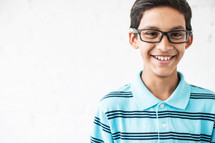 smiling boy child wearing reading glasses