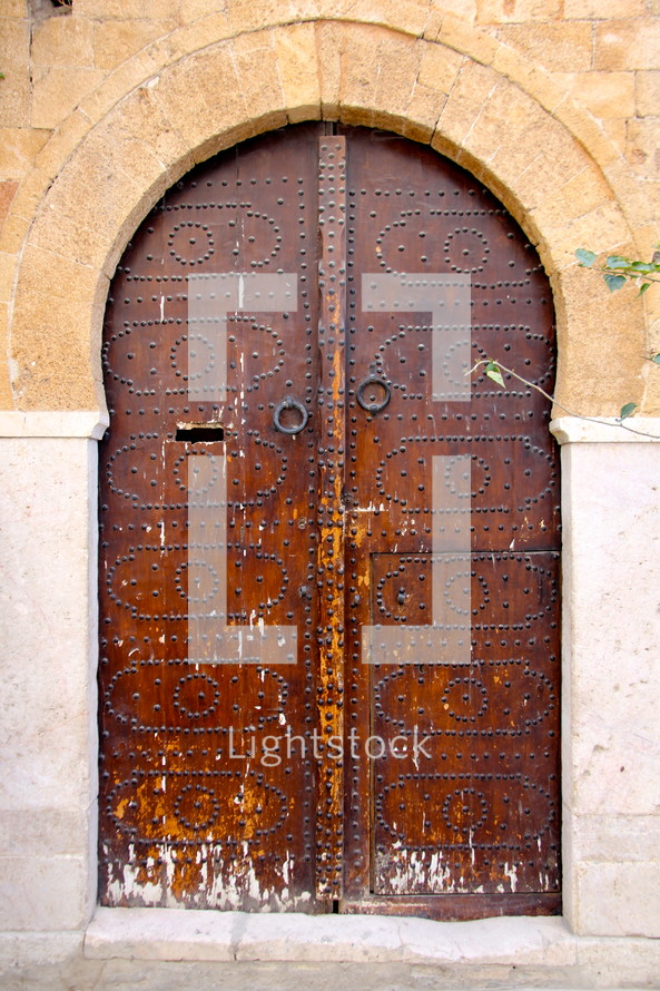 Decorative oriental wooden arched doors
