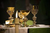 priests preparing communion at the altar