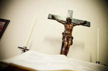 Crucifix and open Bible at an altar