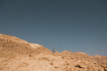 a man standing on a desert mountain in Israel