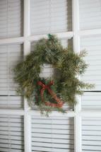 Christmas wreath on a window