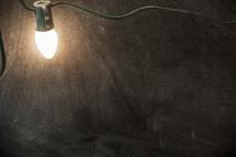 glowing lightbulb over a chalkboard