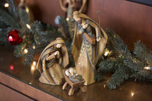 Christmas nativity with lights and garland.