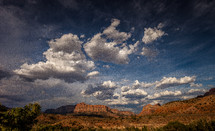 clouds over peaks in a canyon