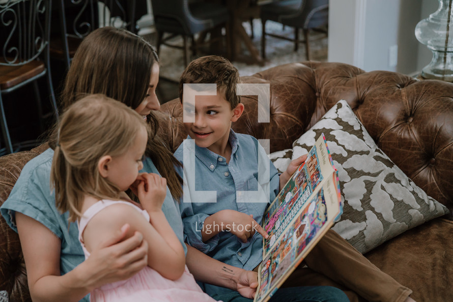 a mother reading to her children