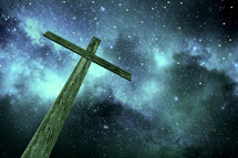 wooden cross under stars in the night sky