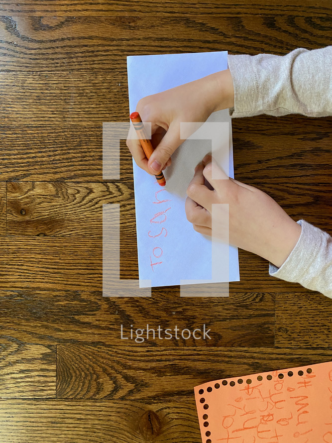 a child writing a letter to Santa