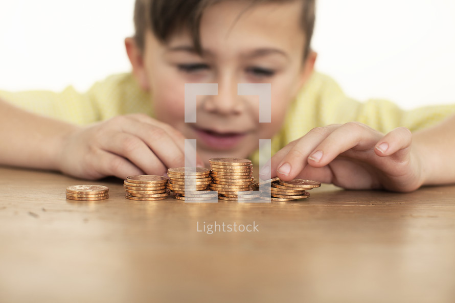 a boy counting gold coins.