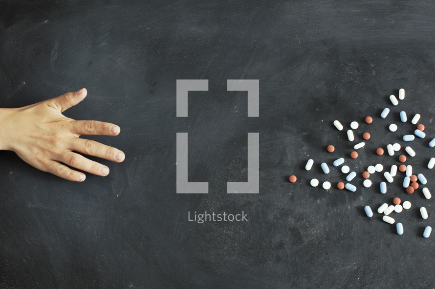hand reaching for pills