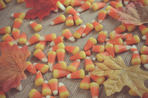 candy corn and autumn leaves