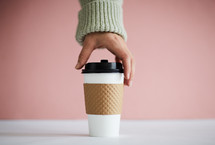 hand taking a coffee cup