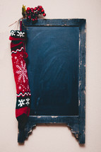 chalkboard with a Christmas stocking
