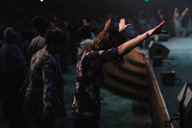 hands raised at a worship conference