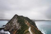 cliffs along a shoreline and path