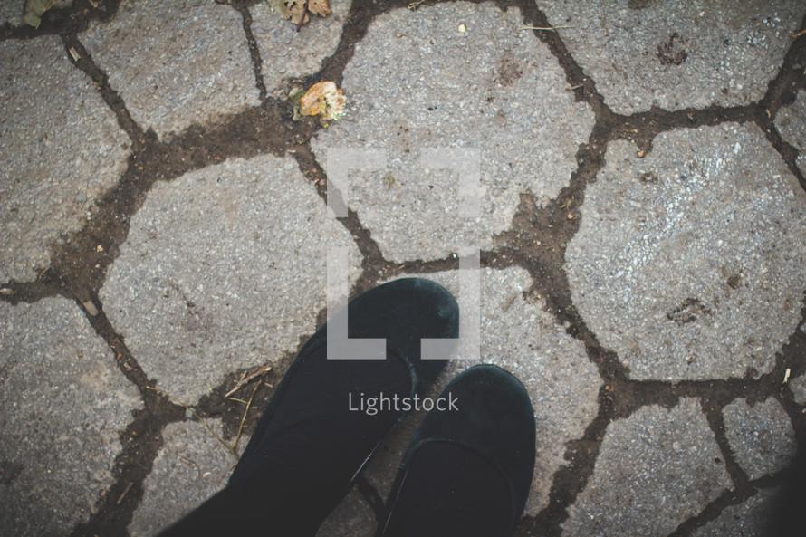 feet on paver stones