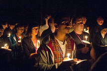 holding candles during a prayer vigil