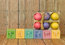 Easter sign of wood blocks and Easter eggs