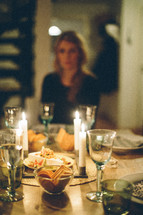 woman sitting at a dinner table
