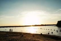 kids playing on a lake beach
