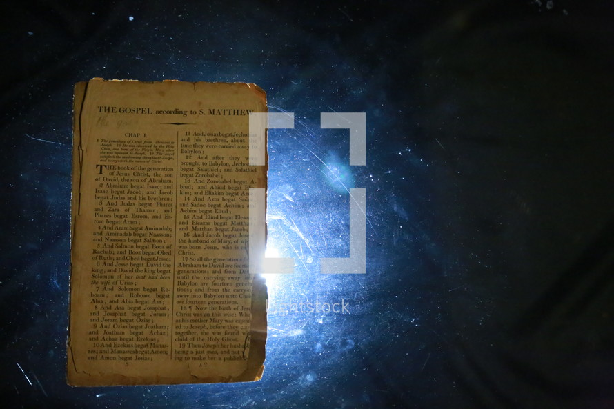 Worn bible pages torn out