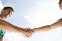 a hand shake between two people.