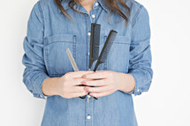 hairdresser holding scissors and combs