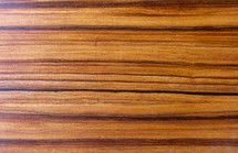 Polished wooden surface showing natural grain of a hardwood tree
