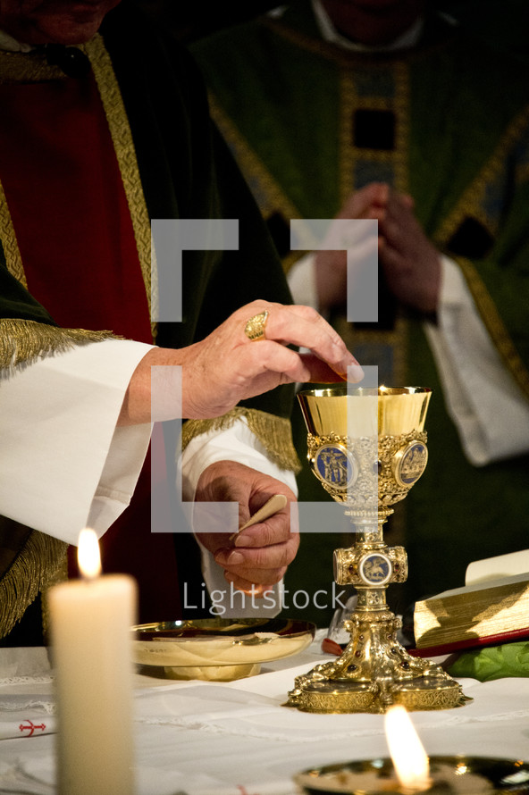 priests preparing communion