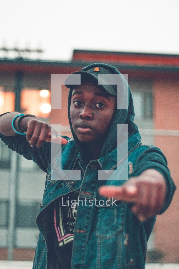 teen boy pointing at the camera
