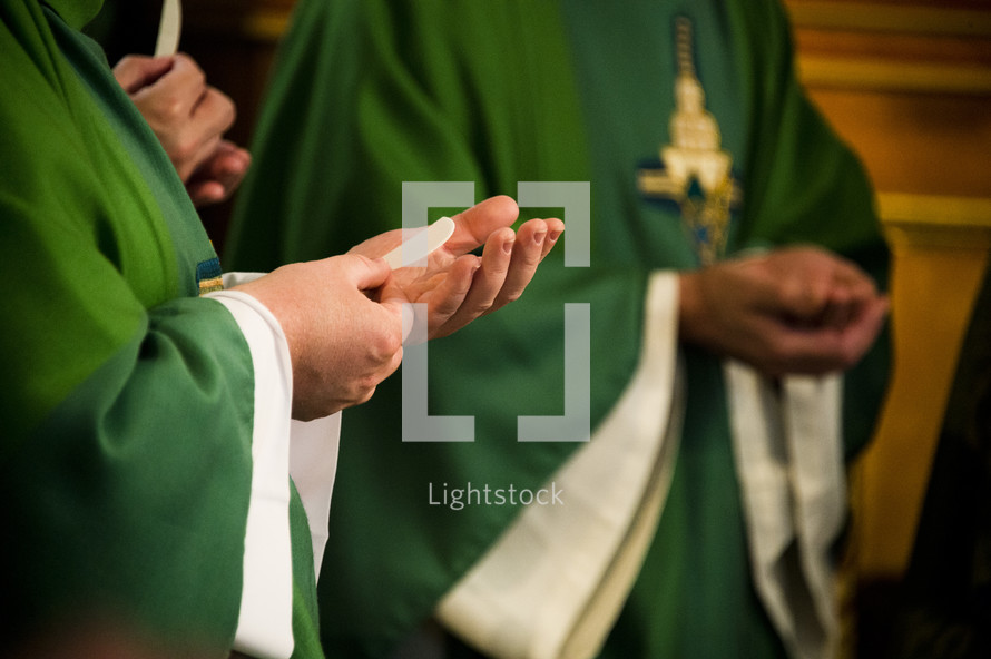 priests taking communion
