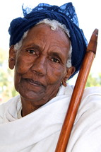 Ethiopian Orthodox woman holding a prayer cane [For similar search Ethnic Smile Face].