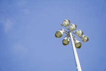stadium lights against a blue sky