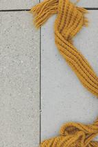Scarf lying on the sidewalk