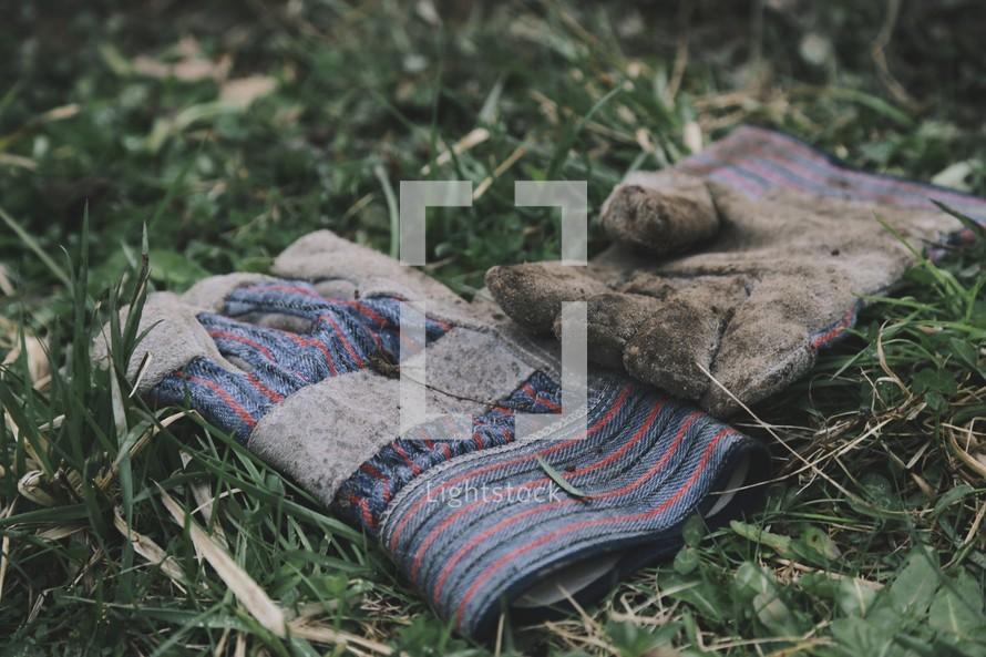 work gloves in the grass