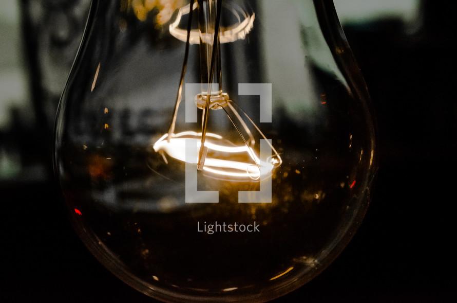 glowing filaments in a lightbulb