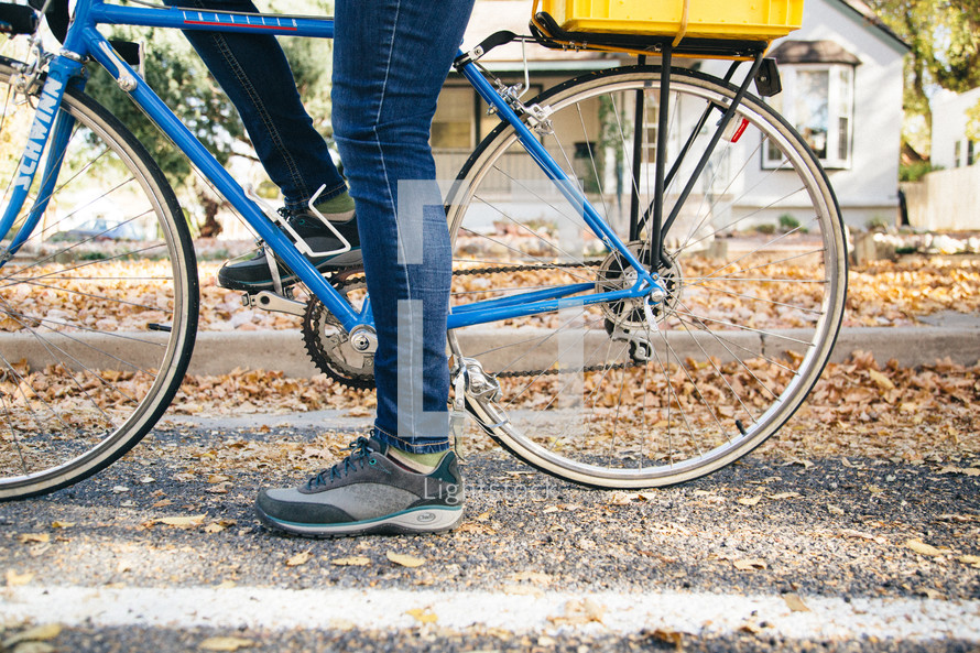 a bicycle and a woman's legs